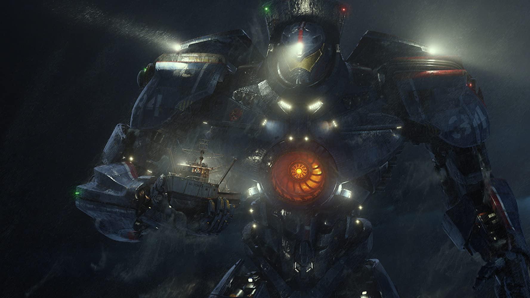Når Jaegeren Gypsy Danger skal møde en Kaiju (et monster fra en anden dimension) går det vildt for sig – specielt med Raleigh Becket (Charlie Hunnam) og Mako Mori (Rinku Kikuchi) ved roret. (Foto: Warner Bros.)